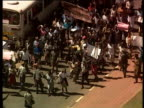 Zimbabweans protesting in support of President Mugabe's polices over seizing land from white farm owners 2000s