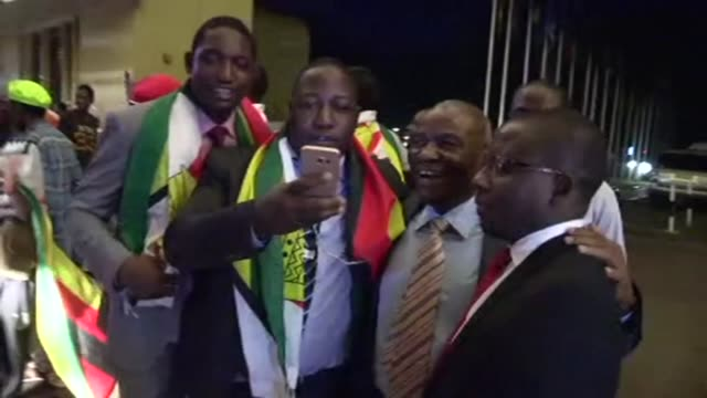 Zimbabweans react to president Mugabe's resignation in the streets of Harare