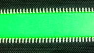 Zipper on green screen.