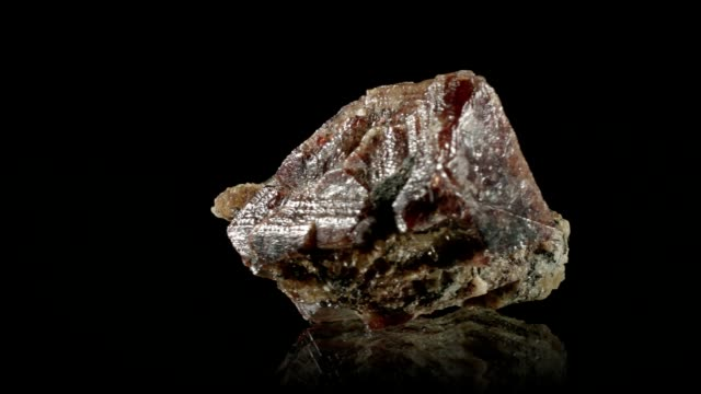 Zircon crystal rotating on black