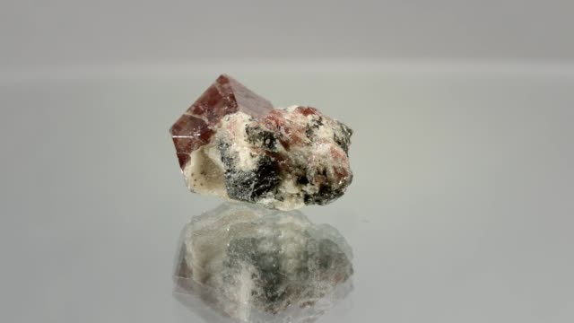 Zircon crystal rotating on white