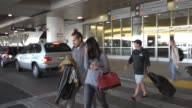 Zoe Saldana and Marco Perego at Los Angeles International Airport at Celebrity Sightings in Los Angeles on November 20 2015 in Los Angeles California
