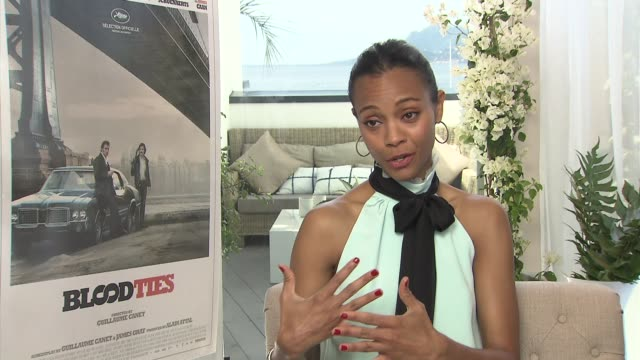 INTERVIEW Zoe Saldana on how Guillaume Canet approached telling an American story with a French twist at 'Blood Ties' Interview at Palais des...