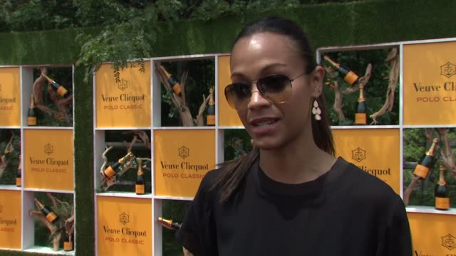 Zoe Saldana talks about the event and charity work at The Fifth Annual Veuve Clicquot Polo Classic at Liberty State Park on June 02 2012 in Jersey...