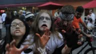 Zombies of all ages shapes and sizes converged on the 16th Street Mall for Denvers 6th annual Zombie Crawl October 22 2011 Denver Zombie Crawl at...