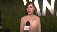 INTERVIEW Zooey Deschanel on getting ready tonight on her Valentino dress jokes that she's been coming to the party for 12 years and once stepping on...