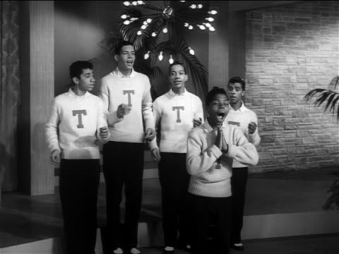 B/W 1956 zoom in Frankie Lymon Teenagers performing 'I'm Not a Juvenile Delinquient' on small stage