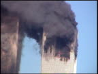 Zoom in on burning Twin Towers with debris and paper falling from windows / zoom out shot from Brooklyn / CU one tower of WTC building with debris...