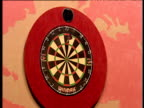 Zoom in on dartboard as Raymond van Barneveld scores 180 at the oche removes darts Dutch fans cheer 2003 Embassy World Darts Championships Lakeside...
