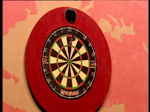 Zoom in on dartboard as Raymond van Barneveld scores 180 at the oche removes darts Dutch fans cheer 2003 Embassy World Darts Championships Lakeside...