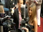 Zoom in on Jennifer Aniston talking to gaggle of journalists at London premiere of 'The Break Up' 14 June 2006