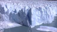 Zoom in on Perito Moreno Glacier calving into Lago Argentino, Patagonia