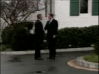 Zoom in on President George W Bush and Al Gore shaking hands Washington DC Dec 00