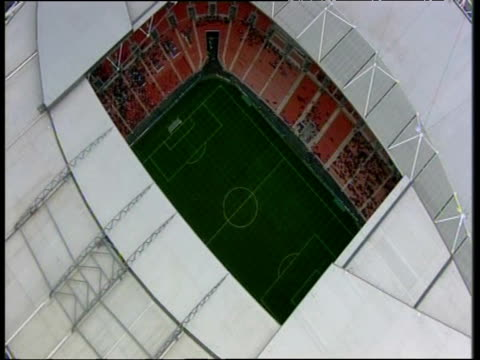Zoom in through roof of Wembley Stadium to match taking place on FA Community Day London; 17 Mar 07