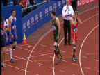 Zoom in to carbon fibre blades of Oscar Pistorius as he lines up at start of Men's T44 100m Final Paralympic World Cup Manchester Regional Arena 2005