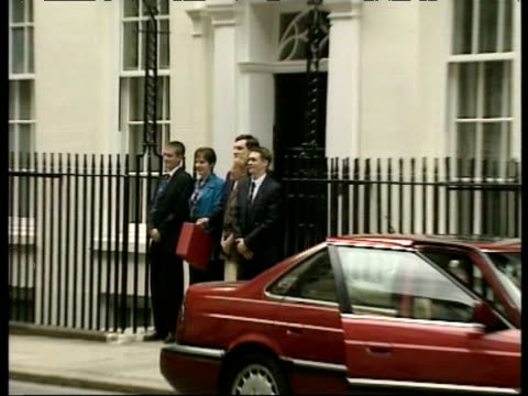 Zoom in to Chancellor Gordon Brown holding red budget box outside 11 Downing Street as he announces Labour's first Budget since election win London 2...