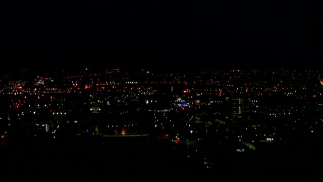 WS ZI  HA Zoom in to city skyline at night / Durban/ South Africa