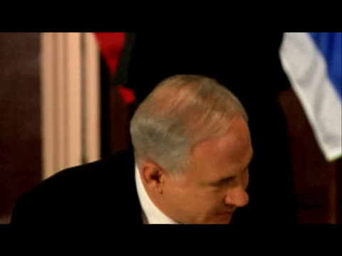 Zoom in to facial expressions of Prime Minister Netanyahu and President Abbas as they sit down for more discussions 22 September 2009nnmeet for UN...
