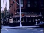 Zoom in to men sitting in diner; 1970s