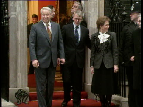 Zoom in to Prime Minister John Major standing with wife Norma and President Boris Yeltsin outside 10 Downing Street London 30 Jan 92