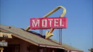 Zoom in to red 'motel' sign w/yellow arrow pointing to roof