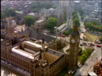 AERIAL zoom in + zoom out Big Ben + Houses of Parliament / London, England