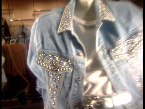 Zoom into mannequin wearing early Nineties silver sequined denim jacket Washington D.C