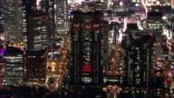 Zoom into Tokyo Metropolitan Government Tower in Shinjuku where Myriad of lights profiles