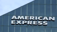 Zoom out American Express sign logo on top of modern building The American Express Company also known as Amex is an American multinational financial...