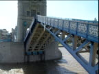 Zoom out and tilt up as Tower Bridge opens London