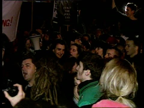Zoom out crowd at peaceful nighttime anti Poll Tax demonstration in Brixton 1990 Poll Tax demonstrations 10 Mar 90