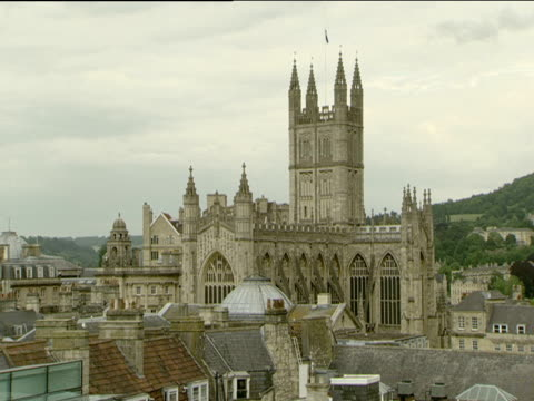Zoom out from Bath Abbey to rooftop swimming pool of new Bath Spa