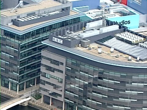 Zoom out from BBC logo on building at Media City Salford Quay
