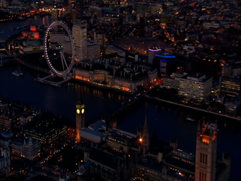 Zoom out from Big Ben to London skyline at night