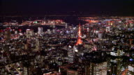 Zoom out from illuminated Odaiba and Rainbow Bridge, track around Tokyo Tower