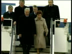 Zoom out from President Boris Yeltsin and wife Naya walking down aeroplane steps as they arrive in Bonn 21 Nov 91
