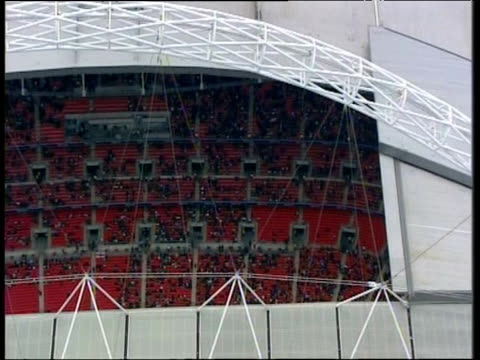 Zoom out from roof of Wembley Stadium London
