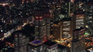 Zoom out from Tokyo Metropolitan Government Tower illuminated by red lights for World AIDS Day