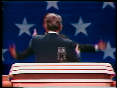 1984 zoom out George Bush joining Ronald Reagan at podium / they shake hands wave / convention