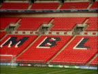 Zoom out over pitch and rows of seats inside Wembley Stadium London