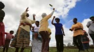 Zoom Shot Xhosa women sing and dance as young men take part in a manhood ceremony in Qunu ahead of the funeral of Nelson Mandela on December 13 2013...