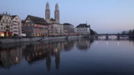 Zurich city across Limmat river twilight