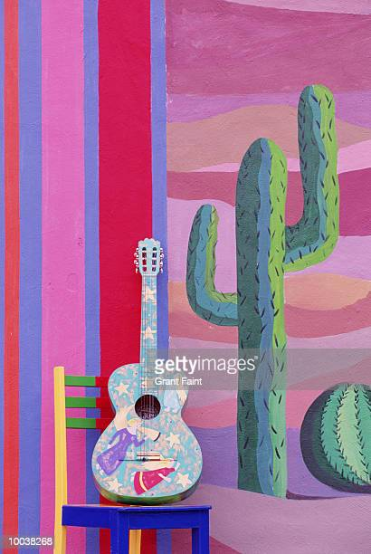 painted guitar, chair & wall in cancun, mexico - painted image stock illustrations