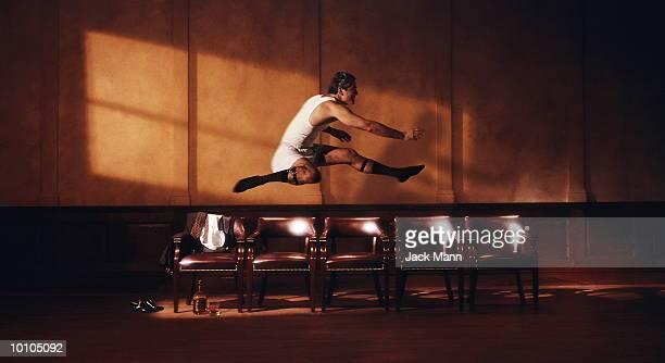 ilustraciones, imágenes clip art, dibujos animados e iconos de stock de businessman jumping - salto de longitud