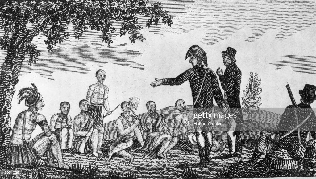 American explorers Meriwether Lewis (1774 - 1809) and William Clark (1770 - 1838) talking with natives during their exploratory journey west of the Mississippi River. Original Publication: From 'Journal of Voyages' by Peter Gass - pub 1811.