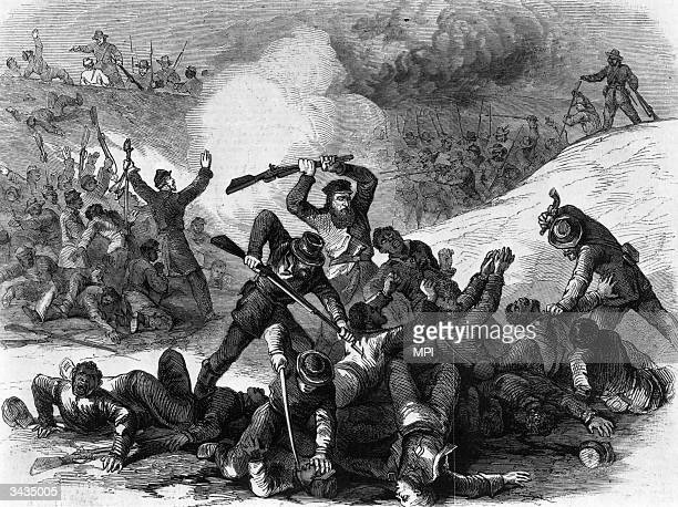 Confederate cavalrymen, led by Nathan Bedford Forrest, later the first Grand Wizard of the Ku Klux Klan , killing unarmed black Union soldiers after...