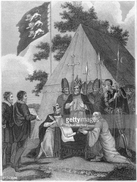 15th June 1215 King John of England signing the Magna Carta at Runnymede near Windsor attended by a group of clergymen and courtiers The Royal...