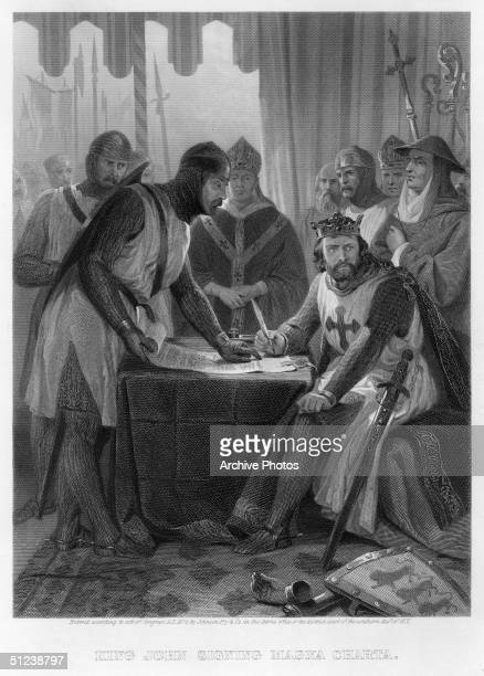15th June 1215 King John reluctantly signs the Magna Carta at Runnymede surrounded by the barons who had drawn up the charter Original Publication...