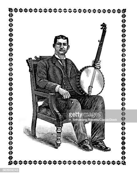 1800s 1890s MAN SITTING IN ORNATE WOODEN ARM CHAIR LOOKING AT CAMERA HOLDING A FIVE STRING BANJO
