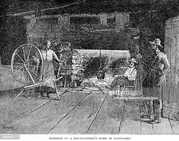 1800s INTERIOR OF TENNESSEE MOUNTAINEER'S CABIN WITH PLANK FLOORING OPEN FIREPLACE IRON KETTLE SPINNING WHEEL THREE PEOPLE